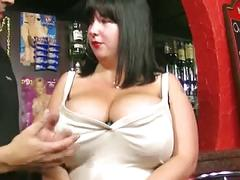 Chubby brunette with enormous tits fucks with bartender