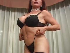 Redheaded milf smokes and takes a pounding