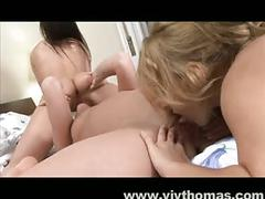 Fantastic threesome scene between two teens and a milf