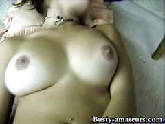 Busty dolly toying her pussy
