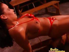 Mistress dressed in red leather sits on slave's face