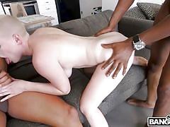 Skinhead girl takes on two black cocks