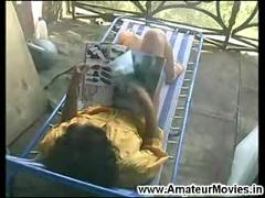 Sexy milf masturbating on terrace