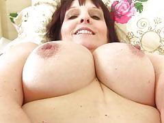 Big tit brunette lady touching herself