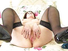 Big tit brunette lady touching herself