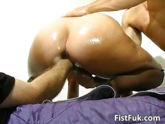 Slut gets her pussy oiled and dildo