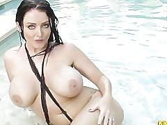 Sophie dee bounces her big tits and plays with pussy in the pool