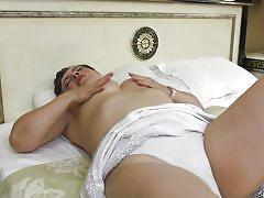 Nasty mature woman masturbates herself