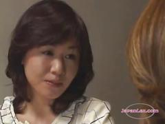 2 asian women kissing patting rubbing tits on the...