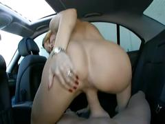 Cute redhead fucked from behind in the backseat