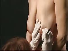 Slave getting tits and pussy piercings - pierced slut