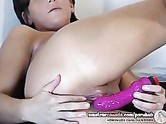 This milf wets up a sex toy while using it