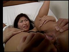 Asian gets her pussy opened wide by boyfriend and fingers her on the bed