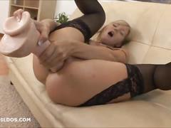 Blonde milf punishes her asshole with a brutal dildo