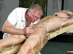 Tied twink ablaze as he gets sucked dry