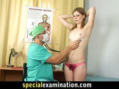 Horny gynecologist examines sweet redhead girl