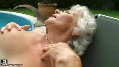 Granny fucks young blonde