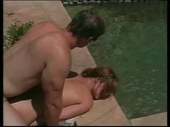 Small-titty teen sucks and takes cock by pool