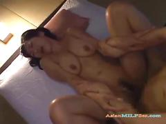 Busty milf getting her hairy pussy fucked by young...