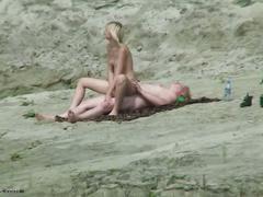 Voyeur spycam on the beach