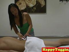 Busty asian babe gives nice massage and handjob