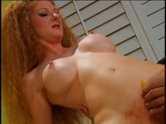 Redhead parts her cunt for a big cock