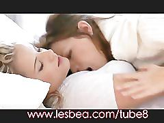Lesbea young girls share wet kisses