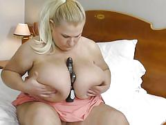 Blonde milf with huge tits masturbates for you!