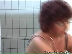Granny rubbing one off in the toilet