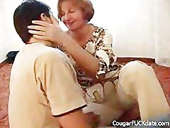 Cougar fucks younger man on the floor