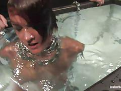 Whore in chains goes underwater
