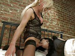 Busty blonde shemale playing with a tied babe