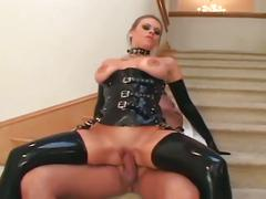Busty blonde in latex hardcore anal sex on stairs