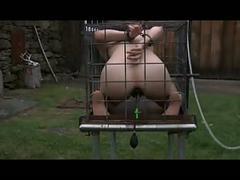 Outdoor bdsm cage locked enema slave