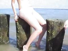Young innocent brunette plays outside at the beach