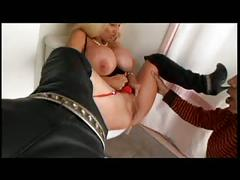 Blonde with huge tits fingers her wet pussy