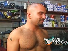Two horny hunks sucking and fucking in garage.