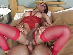 Brunette shemale with big lips receives two loads of cum