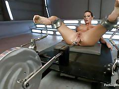 Horny slut playing with the sex machine