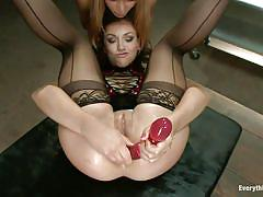 Having fun with a long dildo