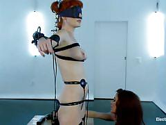 Redhead milf with electrodes on her sexy body