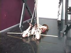 Lovely young slave girl in lingerie is restrained in the sex basement by master