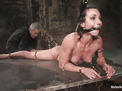 Wenona's starting to enjoy her water bondage!