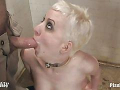 Two guys pissing on a blonde chick