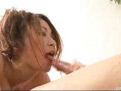 Sara seori uses her feet to fondle two cocks