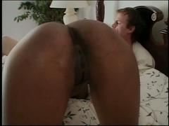 Sexy black chick takes a big white dick and a hot cumshot on the bed