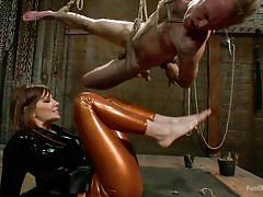 She makes him suck on her toes while hanging from the ceiling
