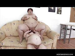 Fat lady is enjoying her dwarf companion