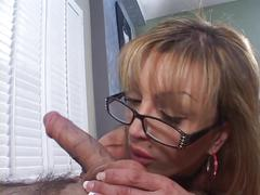 Mature busty blonde sucks big cock