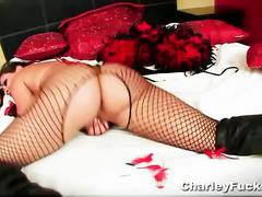 Masked brunette in red hot sexy dress and stocking